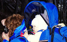 A comfortable baby in a Kelty Explorer, Copyright 1999 - 2004, OutdoorPlaces.Com, All Rights Reserved